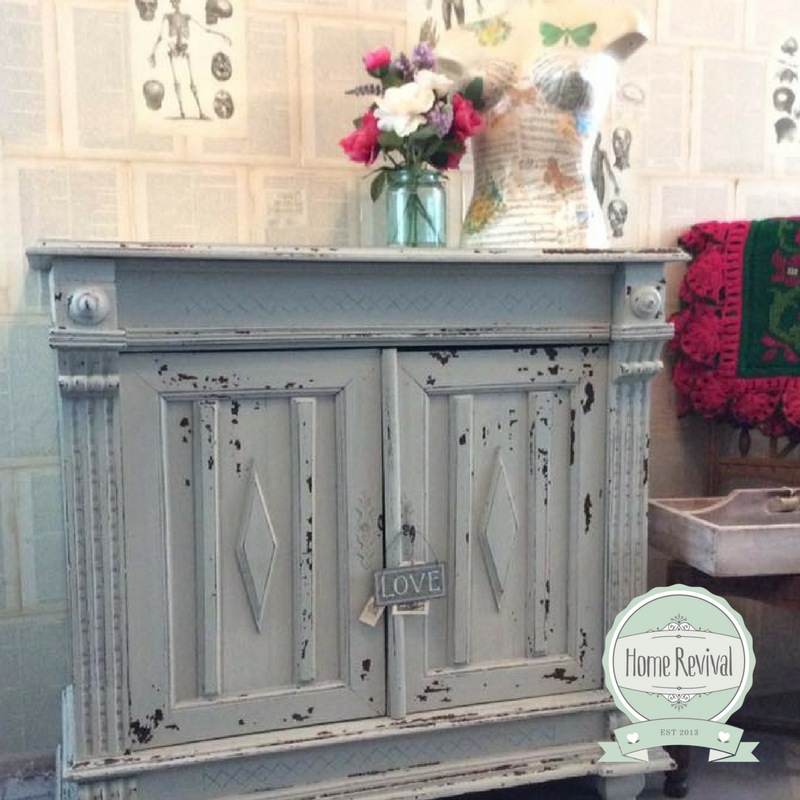 A chippy paint finish on a vintage style sideboard