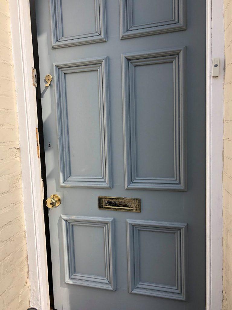 painted front door slightly ajar