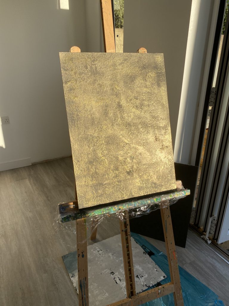 artist Easel catching the sun, with Gold plaster finish
