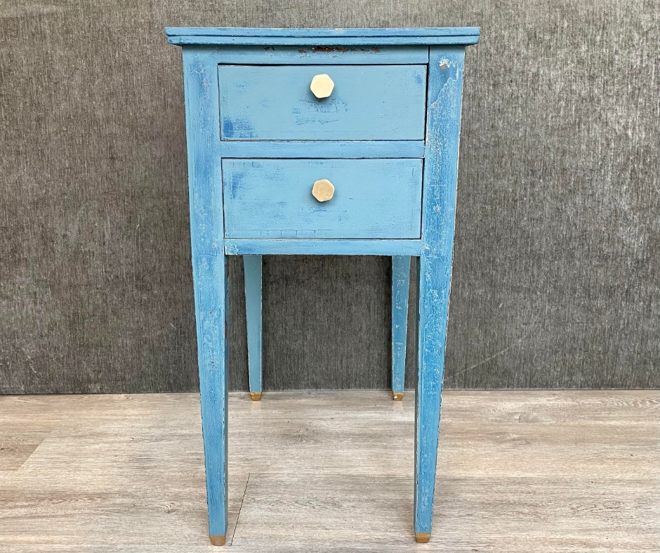 front view of bedside table painted with gold knob handles