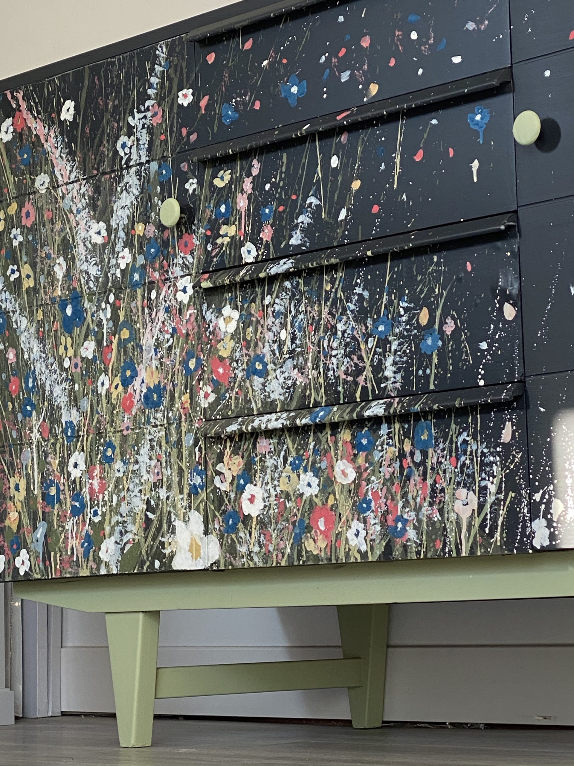 Low view of hand painted milk paint art MCM sideboard